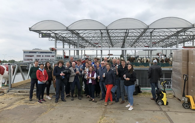 Group photo of Learning Journey participants outside floating dairy