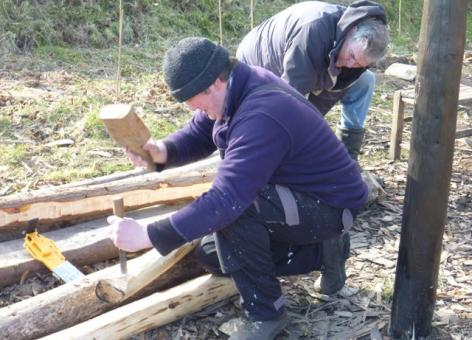 People making wooden structure