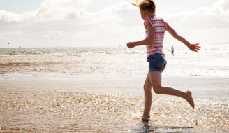 Girl at Saltcoats Beach in Ayrshire copyright Becky Duncan Photography