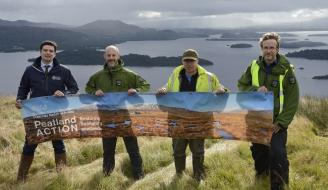 People holding Peatland Action banner