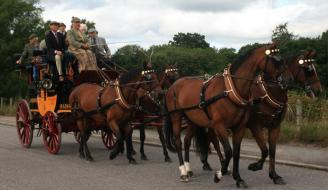 horse drawn coach with passengers