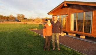 James and Kay Gilchrist outside a chalet