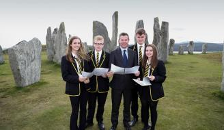 Islands Minister Derek Mackay with school pupils in front of Callanish Stones