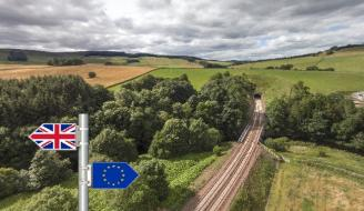 Border railway line with brexit sign