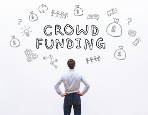 Person looking at Crowd Funding graphic