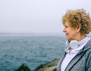 Woman standing beside sea