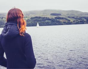 Girl looking out into loch