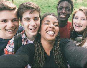 Group of young people smiling at camera
