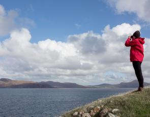 Hebridean Whale and Dolphin Trust Director Alison Lomax looks out for whales © Lucy Hunter