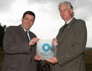 Jamie Hepburn, Minister for Sport, Health Improvement and Mental Health and CNPA Convener, Peter Argyle holding Legacy 2014 award