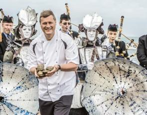 Chef with oysters and pipe band
