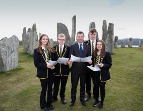 Islands Minister Derek Mackay with school pupils in front of Callanish Stones