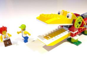 Lego model crocodile and two lego people