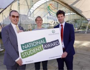 Scottish Land Commission representatives holding National Student Award sign