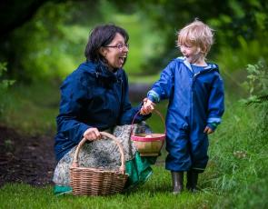 Woman and child on a foraging walk