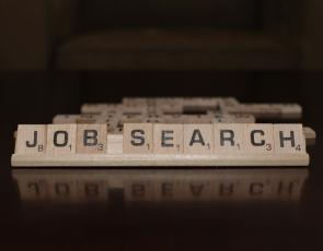 The words 'Job Search' spelled out in scrabble letters