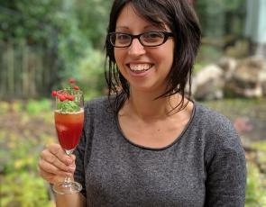 Rox Madeira of Trossachs Wild Apothecary holding a cocktail