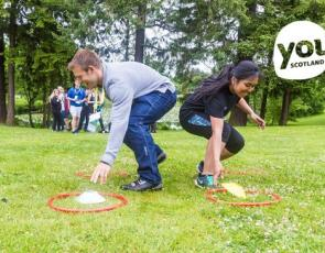 young people playing game with Youth Scotland graphic