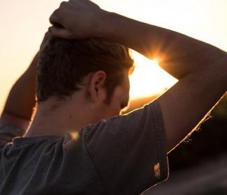 Man standing against sunlight
