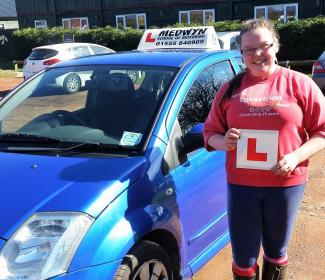 Learner driver Rebecca Black outside learner car