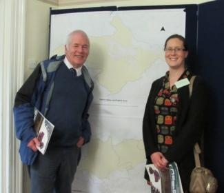 People standing in front of map of Kelvin Valley and Falkirk LEADER areas