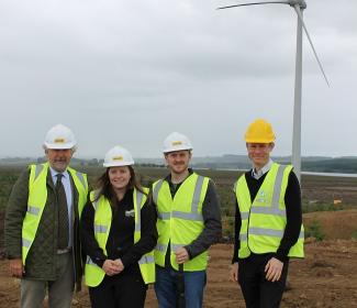 Kari Khevenhuller-Metsch (a director of LDV Harburnhead Ltd), Jemma Black (Development Officer, WAT IF?), Martin Ford-Downes (Secretary, WAT IF?), Paul Phillips (Arcus Consulting) beside wind turbine