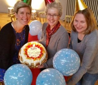 Anne Rowe, Sandra Hogg and Rhonda Mclean of Funding Scotland celebrate with a birthday cake